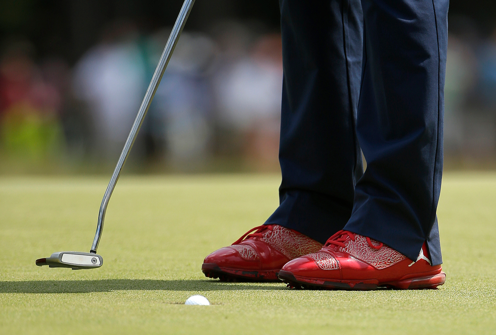 . Keegan Bradley makes his putt on the first hole during the third round of the U.S. Open golf tournament in Pinehurst, N.C., Saturday, June 14, 2014. (AP Photo/Chuck Burton)