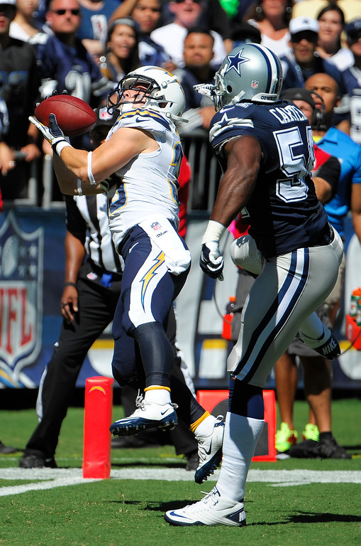 . San Diego Chargers running back Danny Woodhead, left, catches a touch down pass in front on Dallas Cowboys outside linebacker Bruce Carter during the first half of an NFL football game Sunday, Sept. 29, 2013, in San Diego. (AP Photo/Denis Poroy)