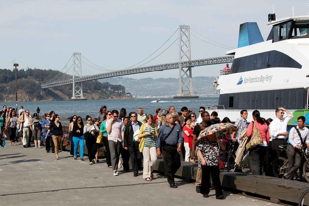. Long lines of afternoon commuters queue up near the Ferry Building attempting to get home to the East Bay on the first day of the BART strike in San Francisco, Calif., late Monday afternoon, July 1, 2013. (Karl Mondon/Bay Area News Group)