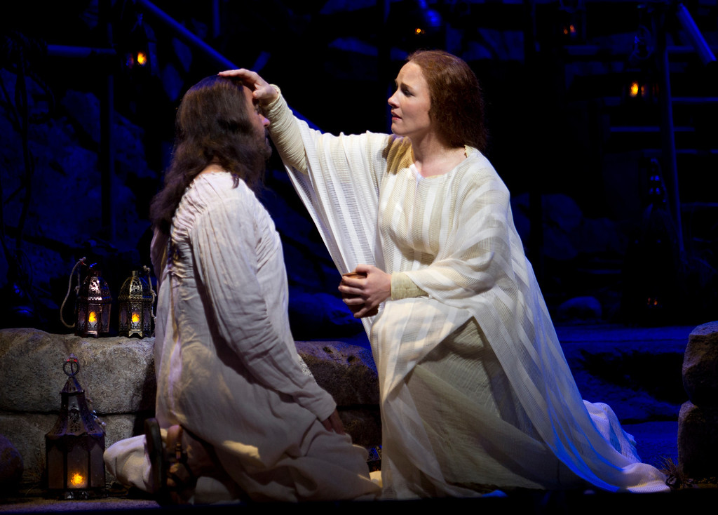 ". Mary Magdalene (Sasha Cooke), right, anoints Yeshua (Nathan Gunn) with oil, in a scene from San Francisco Opera\'s world premiere of Mark Adamo\'s ""The Gospel of Mary Magdalene,\"" Sunday, June 16, 2013 at the War Memorial Opera House in San Francisco. (D. Ross Cameron/Bay Area News Group)"