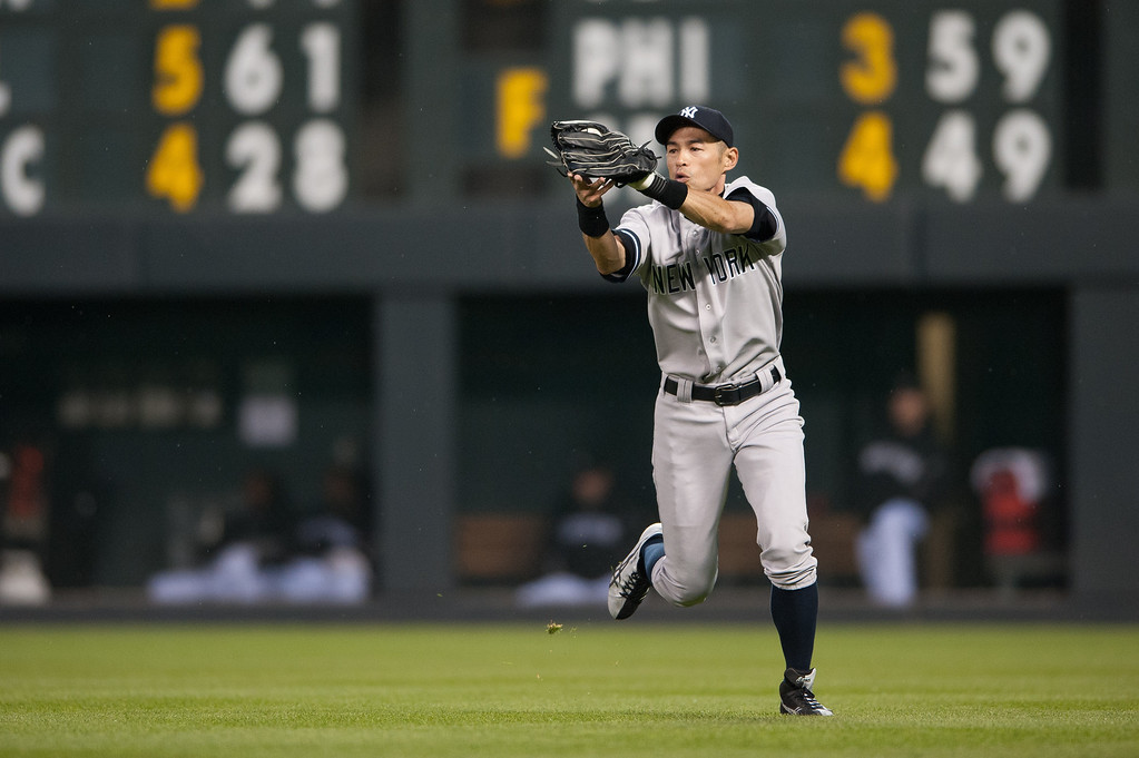. Ichiro Suzuki #31 of the New York Yankees makes a running catch in right field to put out a batter in the fourth inning of a game at Coors Field on May 8, 2013 in Denver, Colorado.  (Photo by Dustin Bradford/Getty Images)