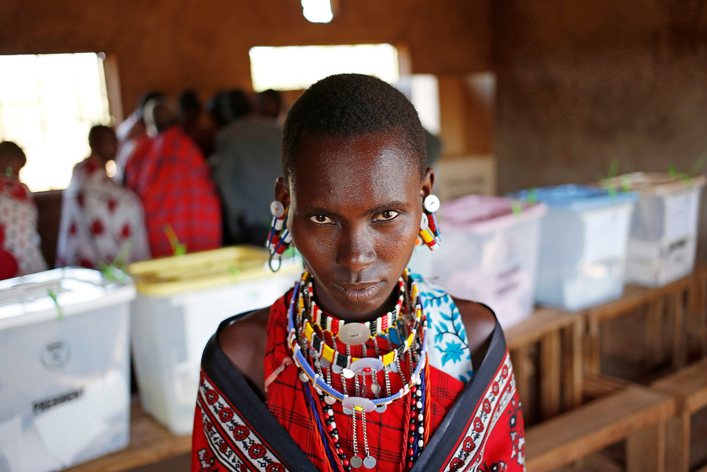. A Masai woman walks out of a polling station after she casts her ballot papers  during the presidential and parliamentary elections near town of Magadi some 85 km (53 miles) south of Nairobi. REUTERS/Goran Tomasevic