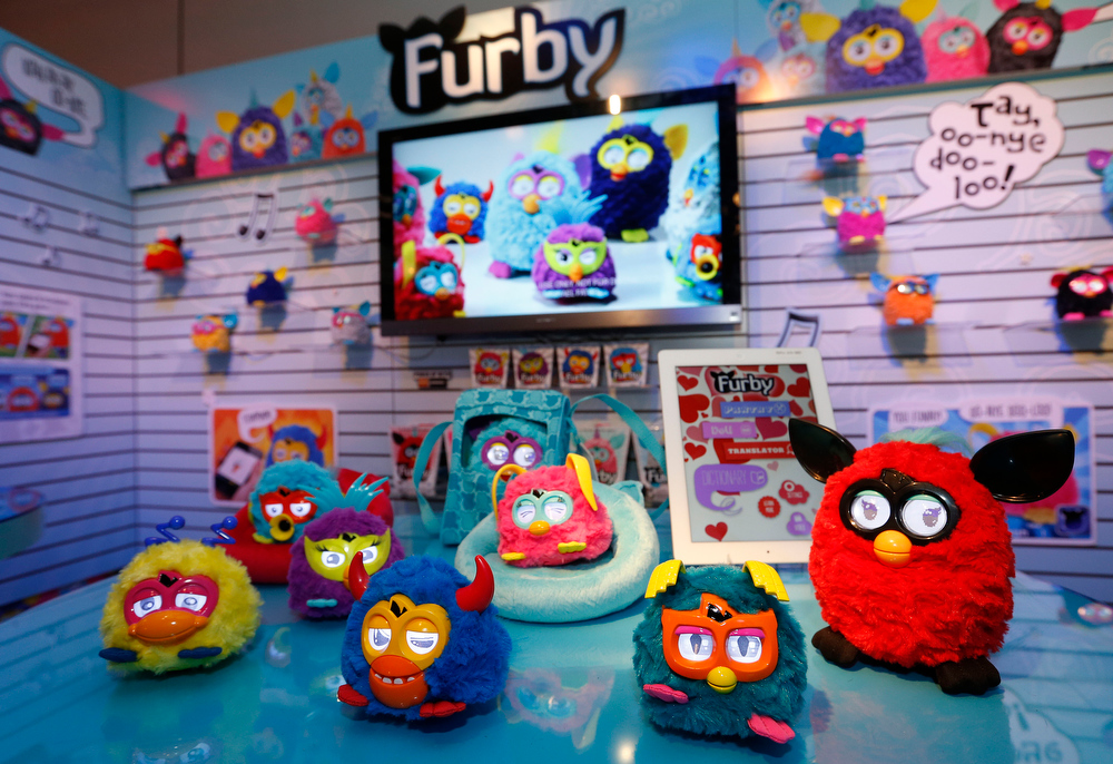 Description of . FURBY PARTY ROCKERS creatures rock out in Hasbroís showroom at the American International Toy Fair, Sunday, Feb. 10, 2013, in New York.  Available this month, each of these funky friends has its own personality, and make a lively companion for the FURBY toy. (Photo by Jason DeCrow/Invision for Hasbro/AP Images)