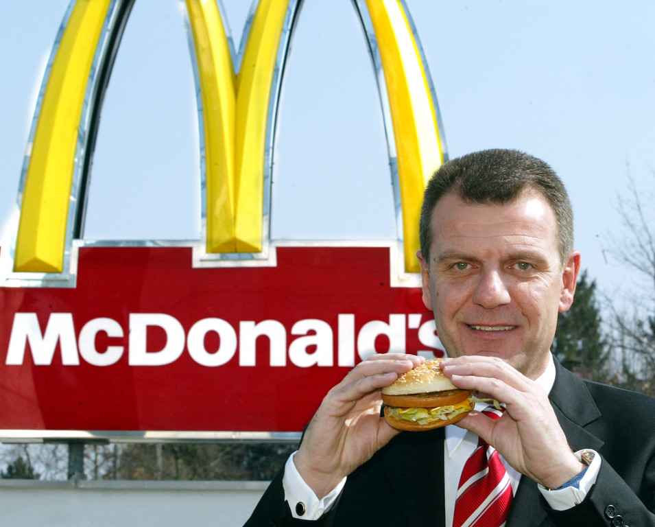 . Adriaan Hendrikx, Marketing Director of McDonalds Germany, holds a Big Mac on Wednesday, March 19, 2003. (AP Photo/Jan Pitman)