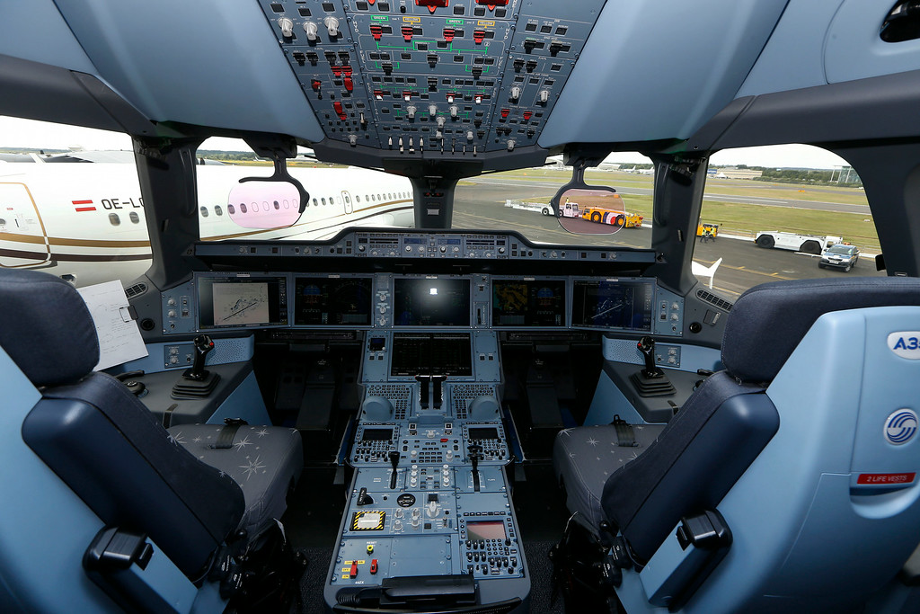 . The cockpit of an Airbus A350 XWB is seen as it stands on display during Farnborough International Air Show, Farnborough, England, Monday, July 14, 2014. (AP Photo/Sang Tan)