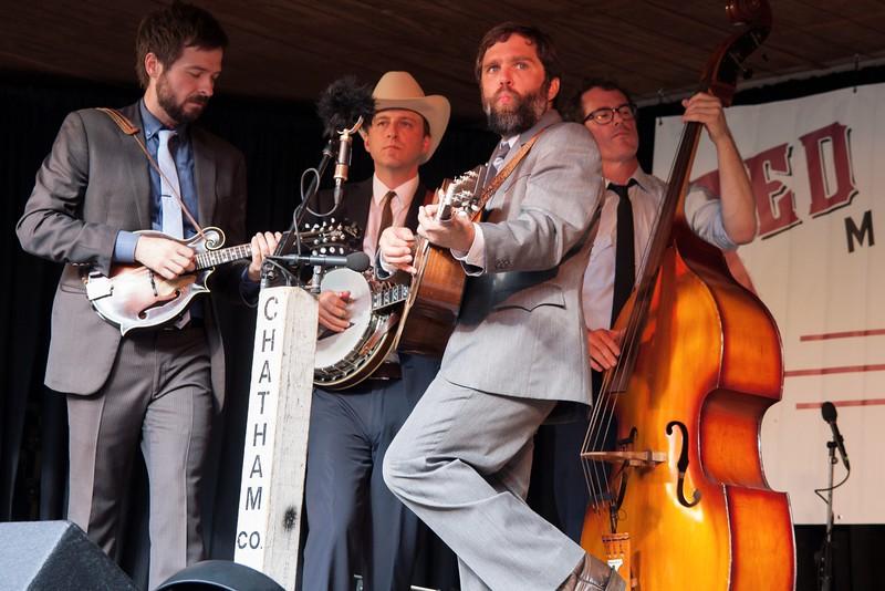John Teer (mandolin), Dave Wilson (guitar), Chandler Holt (banjo), and Greg Readling (bass).