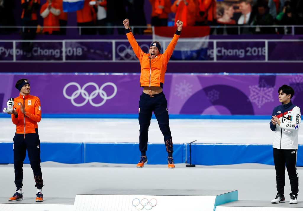 . Gold medallist Kjeld Nuis of The Netherlands, center, jumps for joy on the podium with silver medallist Patrick Roest of The Netherlands, left, and bronze medallist Kim Min-seok of South Korea after the men\'s 1,500 meters speedskating race at the Gangneung Oval at the 2018 Winter Olympics in Gangneung, South Korea, Tuesday, Feb. 13, 2018. (AP Photo/Petr David Josek)