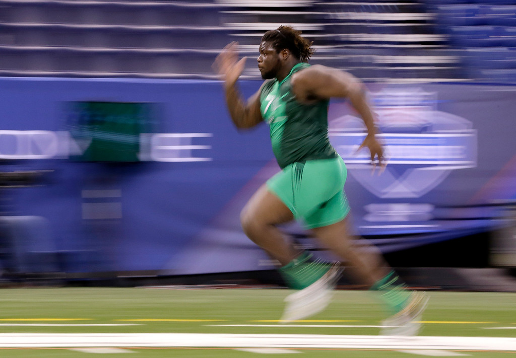 . Texas defensive lineman Malcom Brown runs the 40-yard dash at the NFL football scouting combine in Indianapolis, Sunday, Feb. 22, 2015. (AP Photo/Julio Cortez)