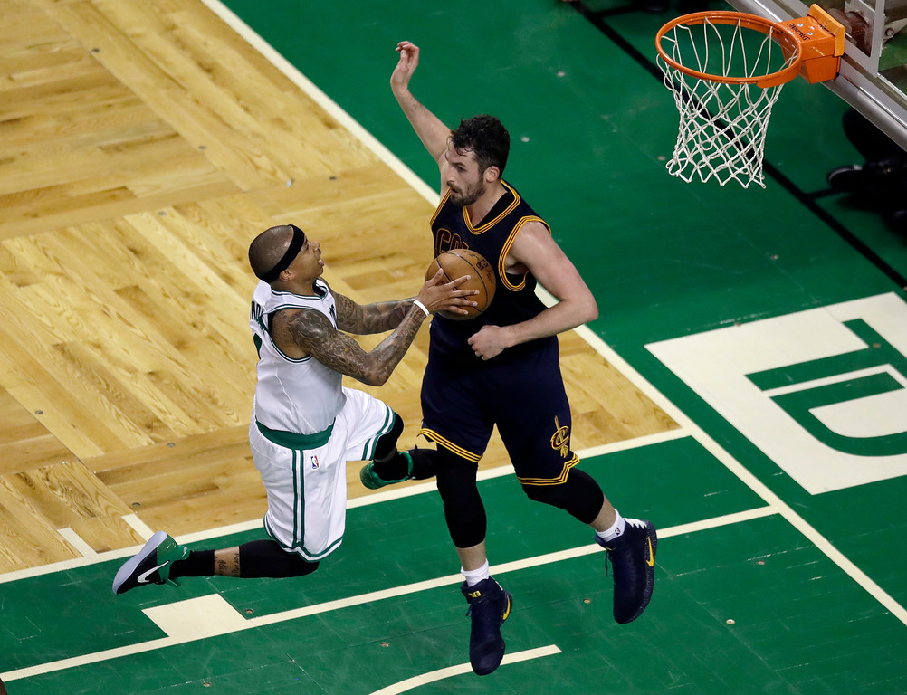 . Boston Celtics guard Isaiah Thomas, left, drives to the basket against Cleveland Cavaliers forward Kevin Love during the second quarter of Game 1 of the NBA basketball Eastern Conference finals, Wednesday, May 17, 2017, in Boston. (AP Photo/Charles Krupa)