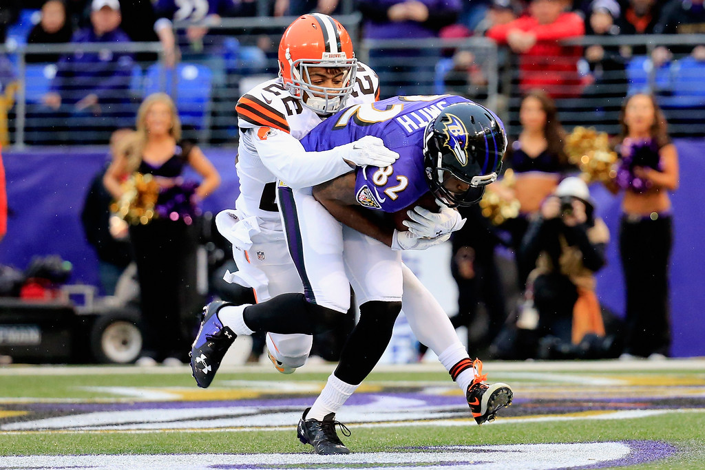 . BALTIMORE, MD - DECEMBER 28:  Wide receiver Torrey Smith #82 of the Baltimore Ravens catches a fourth quarter touchdown pass over the defense cornerback Buster Skrine #22 of the Cleveland Browns at M&T Bank Stadium on December 28, 2014 in Baltimore, Maryland.  (Photo by Rob Carr/Getty Images)