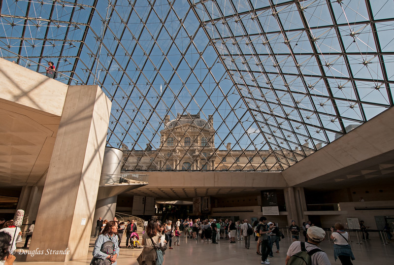 The Lobby of the Louvre, under a glass pyramid.