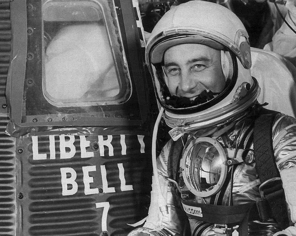 """. FILE- In this July 21, 1961 file photo, astronaut Virgil \""""Gus\"""" Grissom poses next to the space capsule Liberty Bell 7, for his departure from Cape Caneveral, Fla. Grissom was among the crew who perished after a fire broke out inside the Apollo 1 module during a launch rehearsal on Jan. 27, 1967, at the Cape Canaveral Air Force Station, Fla.  (AP Photo/File)"""