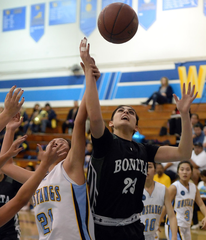 . Bonita\'s Sam Naanouh (23) fights for the rebound with Walnut\'s Audree Hsu (21) in the first half of a prep basketball game at Walnut High School in Walnut, Calif., on Wednesday, Jan. 15, 2014. Bonita won 60-50. (Keith Birmingham Pasadena Star-News)