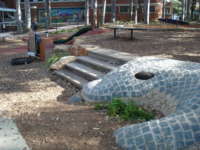 alligator sculpture and musical chimes and timber steps