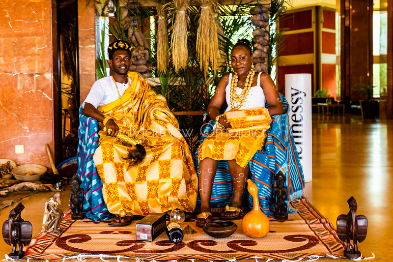 African ivorian culture on display at the president hotel Yamoussoukro. Young man and lady wearing traditional african dress with gold jewelry. Promoting culture. Body decoration on the lady, African hairstyle, cap, decorated with gold.