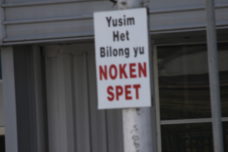 """Pidgin English sign saying """"Use your head and do not spit"""""""