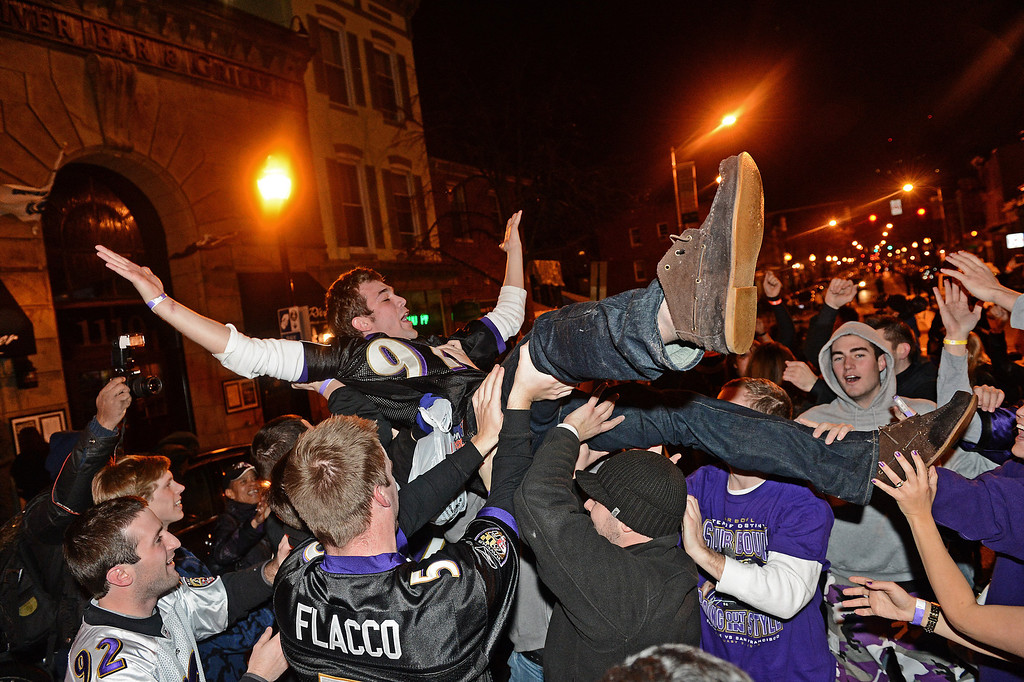 . Baltimore Ravens fans celebrate in the streets after Super Bowl XLVII against the San Francisco 49ers in the neighborhood of Federal Hill on February 3, 2013 in Baltimore, Maryland. The Baltimore Ravens won the Super Bowl, 34-31, to capture their second championship title. (Photo by Patrick Smith/Getty Images)