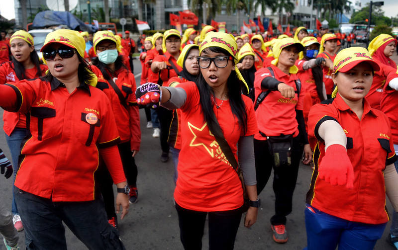 . Indoensian women march during International Women\'s Day in Jakarta on March 8, 2013.  According to the United Nations, women of all continents can look back to a tradition that represents at least nine decades of struggle for equality, justice, peace and development.     BAY ISMOYO/AFP/Getty Images