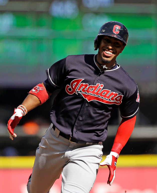 . Cleveland Indians\' Francisco Lindor smiles as he rounds the bases on his solo home run against the Seattle Mariners in the first inning of a baseball game Saturday, Sept. 23, 2017, in Seattle. (AP Photo/Elaine Thompson)