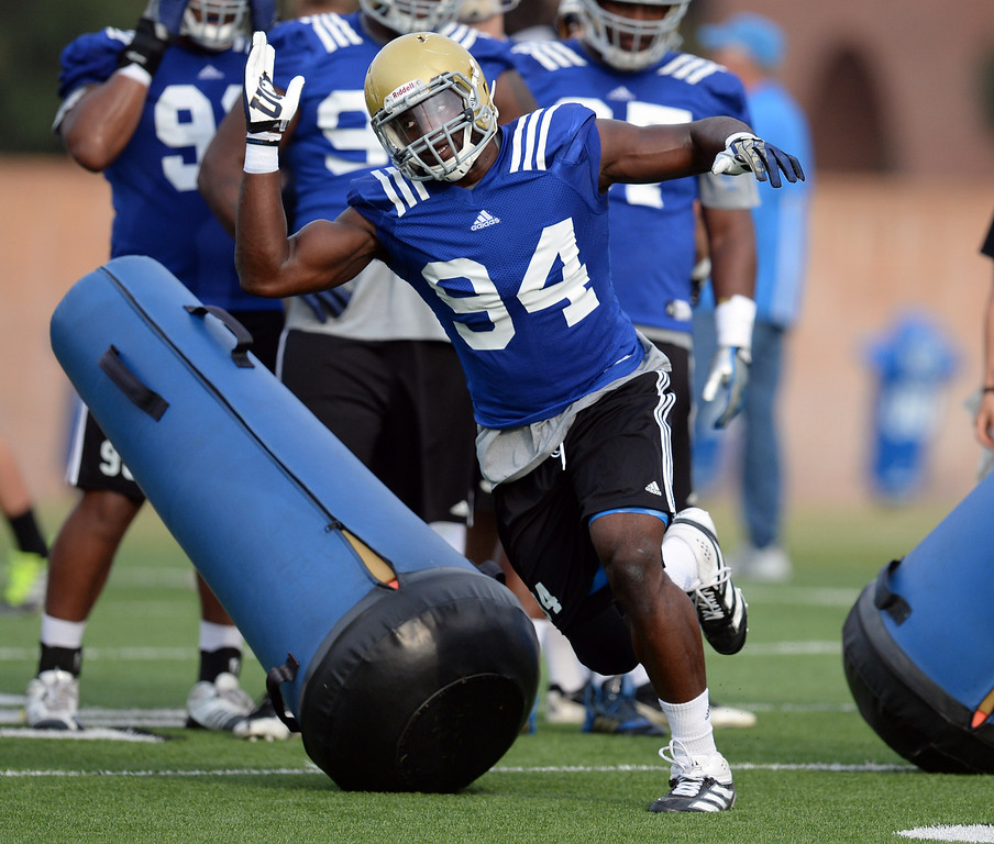 . UCLA\'s Owamagbe Odighizuwa #94 during football practice at Spaulding Field on the UCLA campus Thursday, April 17, 2014. (Photo by Hans Gutknecht/Los Angeles Daily News)