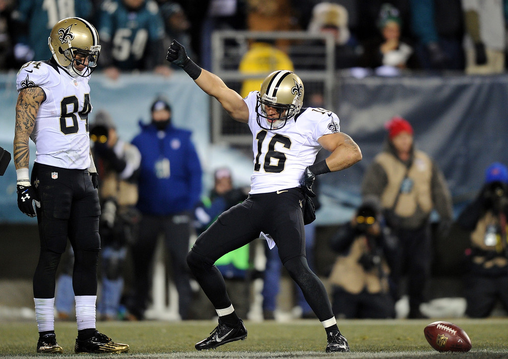 . PHILADELPHIA, PA - JANUARY 04:  Lance Moore #16 of the New Orleans Saints celebrates with teammate Kenny Stills #84 after scoring a 24 yard touchdown thrown by Drew Brees #9 in the third quarter against the Philadelphia Eagles during their NFC Wild Card Playoff game at Lincoln Financial Field on January 4, 2014 in Philadelphia, Pennsylvania.  (Photo by Maddie Meyer/Getty Images)