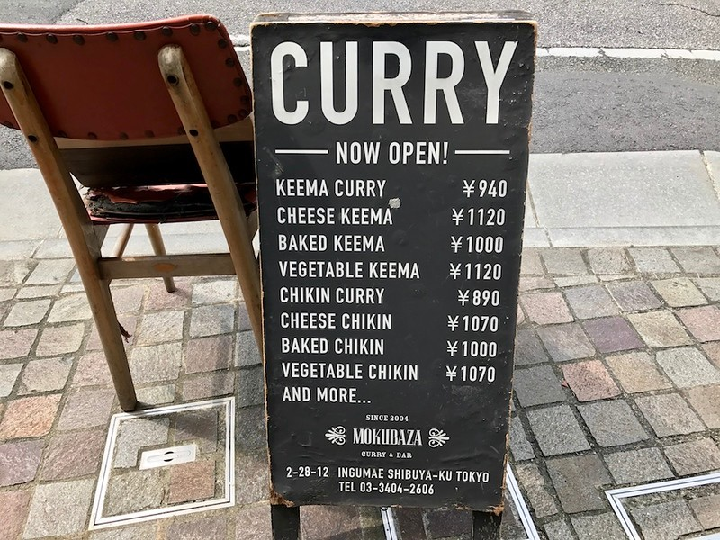 The back of the sandwich board has an English menu. Prices on this are not up-to-date.