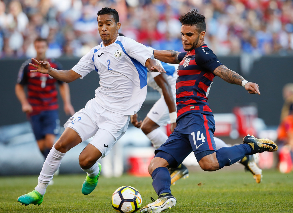 . United States\' Dom Dwyer (14) takes a shot past Nicaragua\'s Josue Quijano (2) during a CONCACAF Gold Cup soccer match in Cleveland, Ohio, Saturday, July 15, 2017. (AP Photo/Ron Schwane)