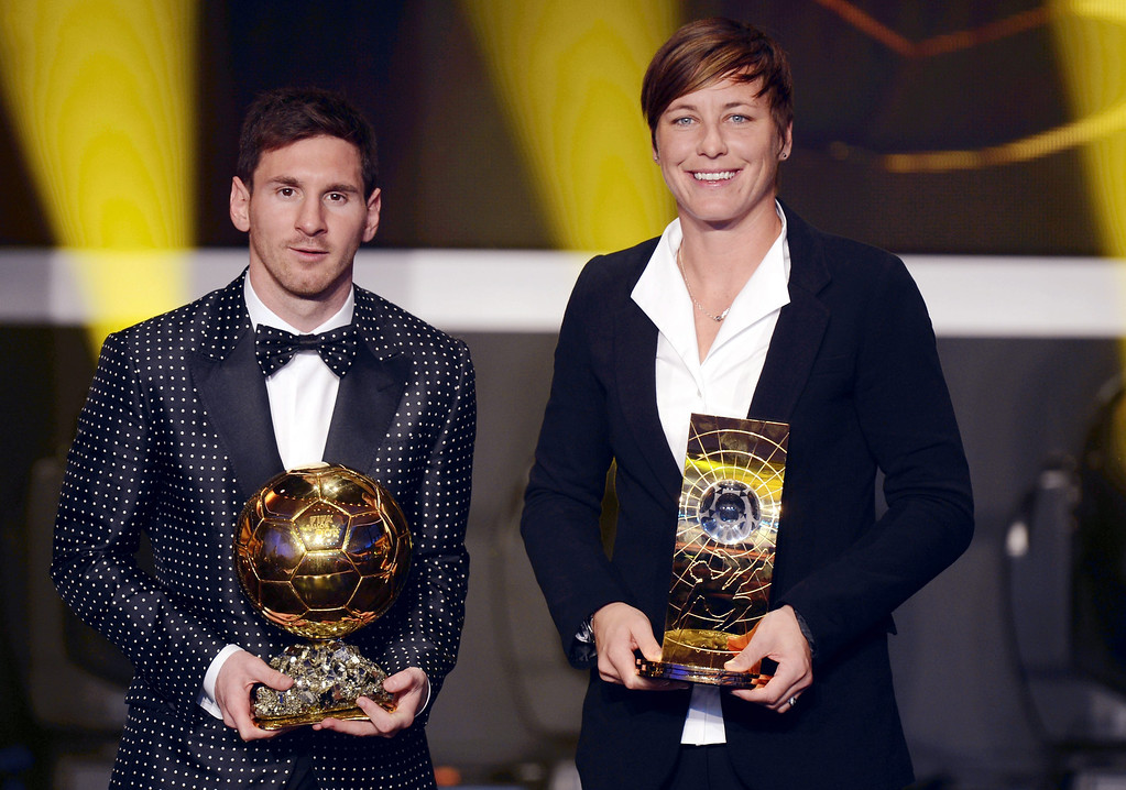. Argentina`s Lionel Messi, left, and US Abby Wambach, right, pose with their trophies after winning the World Player of the Year Awards during the FIFA Ballon d\'Or Gala 2013 held at the Kongresshaus in Zurich, Switzerland, Monday, Jan. 7, 2013. (AP Photo/Keystone, Walter Bieri)