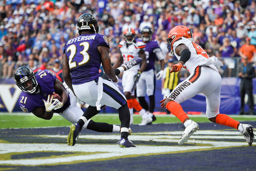 . Baltimore Ravens free safety Lardarius Webb (21) intercepts a pass intended for Cleveland Browns Rashard Higgins (81) during the second half of an NFL football game in Baltimore, Sunday, Sept. 17, 2017. (AP Photo/Nick Wass)