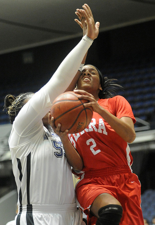 . 02-27-2012--(LANG Staff Photo by Sean Hiller)- Serra vs. Windward in Wednesday\'s girls basketball CIF SS Div. 4AA title game at the Anaheim Convention Center Arena in Anaheim. Windward\'s Kristen Simon (55) heavily guards Kayla Bibb (2).