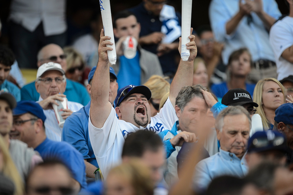 . Dodger fans celebrate Dodgers scoring in game 3 of the NLCS Monday October 14, 2013 ( Photo by Hans Gutknecht/Los Angeles Daily News )