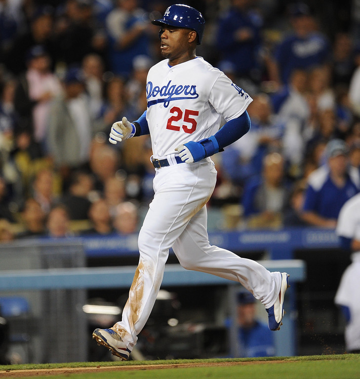 . Los Angeles Dodgers\' Carl Crawford scores on a sac foul fly ball by Adrian Gonzalez (not pictured) in the third inning of their baseball game against the San Diego Padres on Wednesday, April 17, 2013 in Los Angeles.   (Keith Birmingham/Pasadena Star-News)