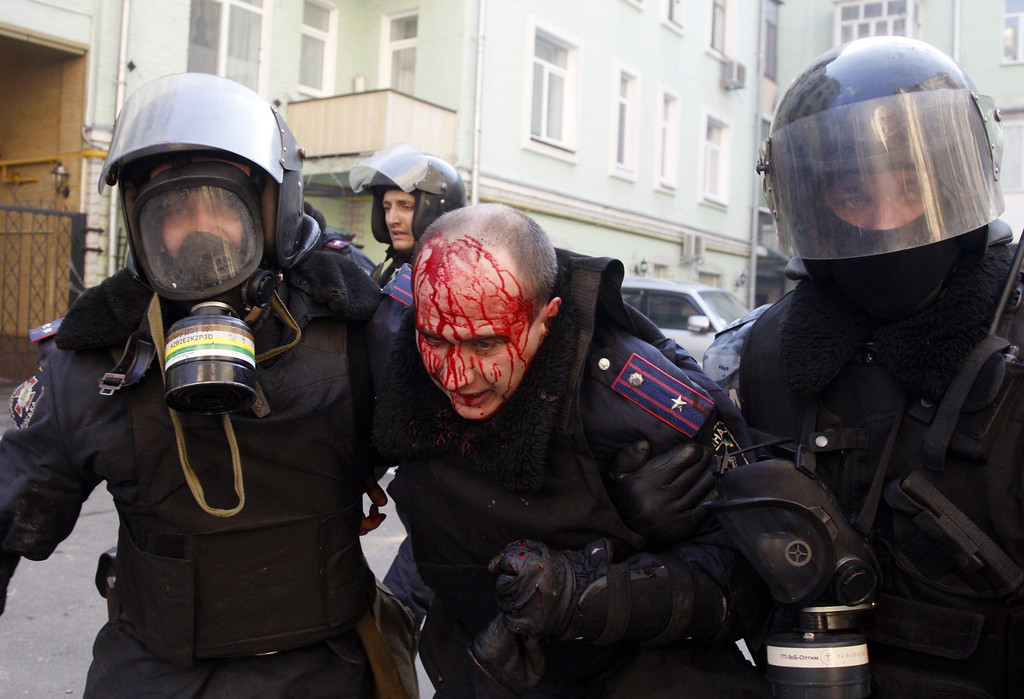 . Policeman evacuate a wounded colleague during clashes with anti-government protesters in Kiev on February 18, 2014. Ukrainian anti-government protestors on Tuesday took back control of Kiev\'s city hall following bloody clashes with riot police just two days after vacating the building, an AFP correspondent at the scene said. Protesters guarded the entrance and some 30 activists were setting up a first aid point inside the building, which the opposition had left on Sunday as part of an amnesty deal with the authorities. AFP PHOTO/ ANATOLII STEPANOV/AFP/Getty Images