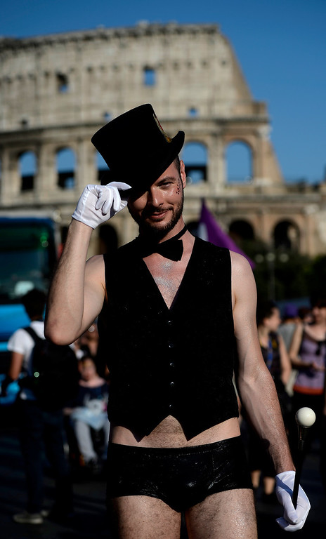 . A dressed up demonstrator takes part in the annual gay pride parade in downtown Rome on June 15, 2013. Tens of thousands of people paraded noisily on floats through the historic streets of Rome on June 15 to celebrate Gay Pride, amid calls for Italy to follow France\'s example in legalising gay marriage.  AFP PHOTO/ FILIPPO  MONTEFORTE/AFP/Getty Images