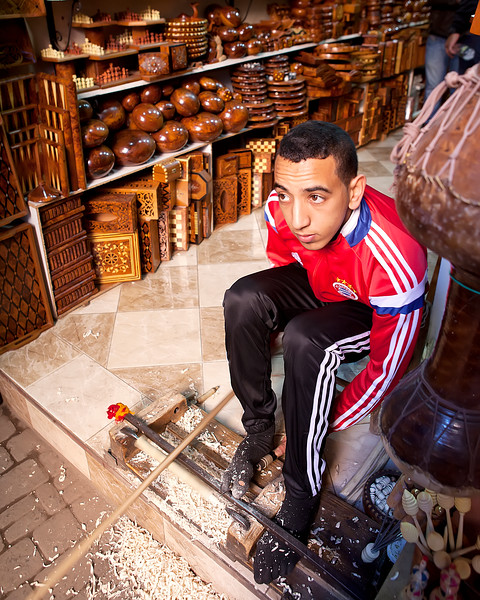 marrakech-souk-turning-wood-with-foot-bow-manual-lathe-with-shop-background.jpg