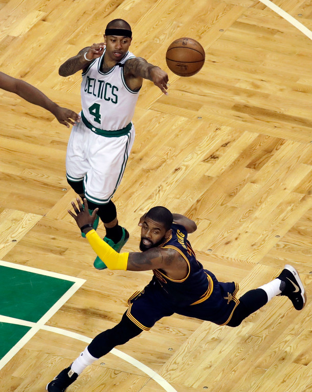 . Boston Celtics guard Isaiah Thomas (4) passes the ball as Cleveland Cavaliers guard Kyrie Irving (2) defends during the first quarter of Game 2 of the NBA basketball Eastern Conference finals,, Friday, May 19, 2017, in Boston. Thomas did not return in the second half due to a strained right hip. (AP Photo/Elise Amendola)