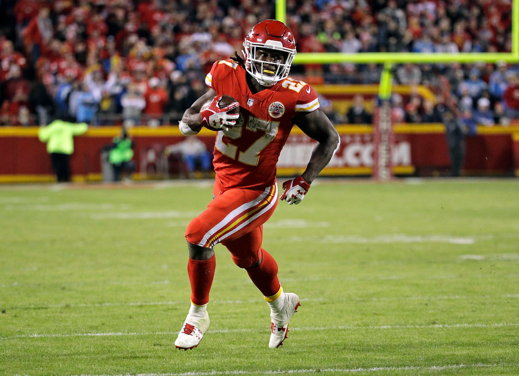 . Kansas City Chiefs running back Kareem Hunt (27) carries the ball during the second half of an NFL football game against the Los Angeles Chargers in Kansas City, Mo., Saturday, Dec. 16, 2017. (AP Photo/Charlie Riedel)