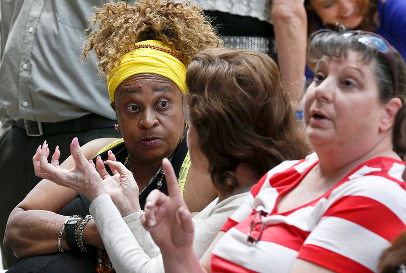 . From left to right, Varbette Knight, of Avondale, Ariz., Frances Varner, of Scottsdale, Ariz., and Christine Johnston, of Arizona City, talk about their verdict predictions as they sit out in front of Maricopa County Superior Court Monday, May 6, 2013, in Phoenix. A Phoenix jury is on its second day of deliberations in the trial of Jodi Arias, who is accused of murdering her one-time boyfriend in Arizona. (AP Photo/Ross D. Franklin)