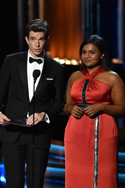 . Actors John Mulaney (L) and Mindy Kaling speak onstage at the 66th Annual Primetime Emmy Awards held at Nokia Theatre L.A. Live on August 25, 2014 in Los Angeles, California.  (Photo by Kevin Winter/Getty Images)