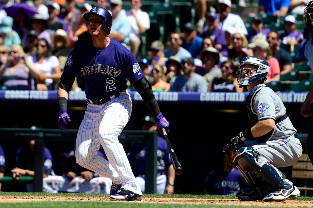 . Colorado Rockies shortstop Troy Tulowitzki (2) watches his home run off of San Diego Padres starting pitcher Clayton Richard (33) during the first inning in Denver. The Colorado Rockies hosted the San Diego Padres at Coors Field on Sunday, June 9, 2013. (Photo by AAron Ontiveroz/The Denver Post)