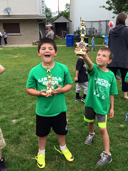 Jack's last baseball and trophies for BB and Tball 2015