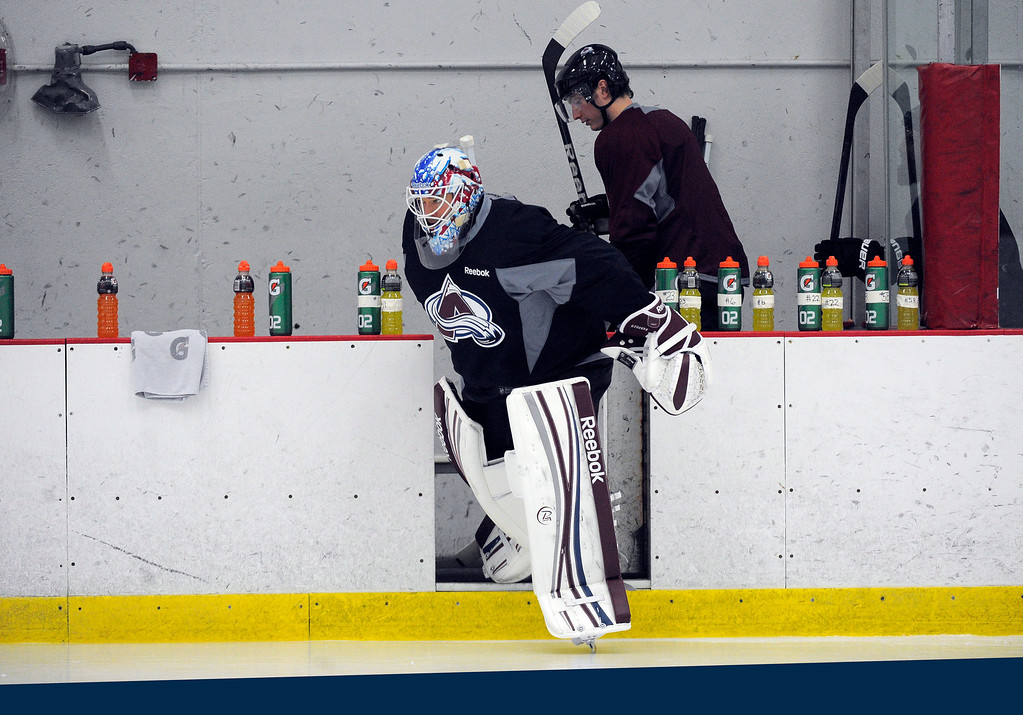 . Colorado Avalanche G J.S. Giguere hits the ice as the Avalanche return to the ice Sunday, January 13, 2013 at Family Sports Center to start the 2013 training camp.  John Leyba, The Denver Post