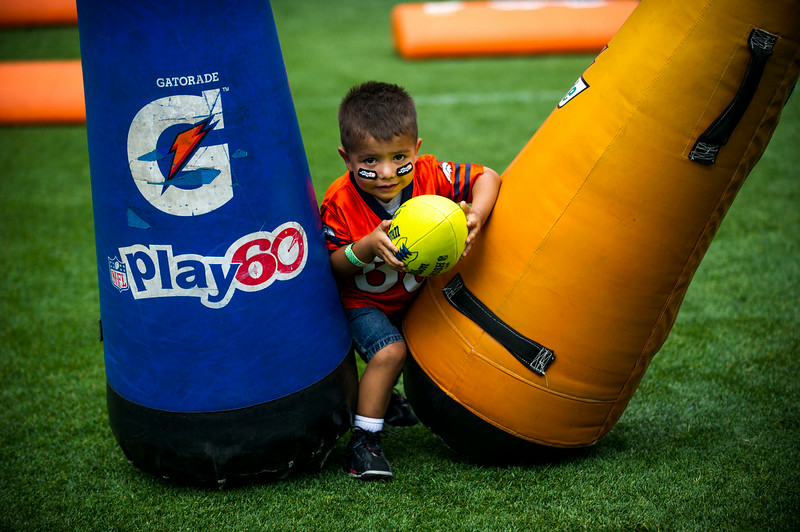 . Cisco Soto, 2, runs through drills during the National Sports Center for the Disabled\'s Denver Broncos Ability Clinic at Sports Authority Field at Mile High on Tuesday, July 08, 2014 in Denver, CO. (Photo by Kent Nishimura/The Denver Post)