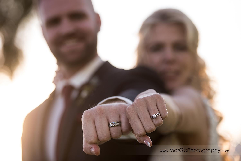 bride and groom showing wedding rings at San Diego Marina Village
