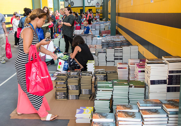 09/04/19 Wesley Bunnell | StaffrrTwenty two thousand books were donated to area educators and parents with children by ESPN and Disney on Thursday September 4, 2019 at New Britain Stadium. Mary Jane Bezares from Prince Technical High School selects books for her students.