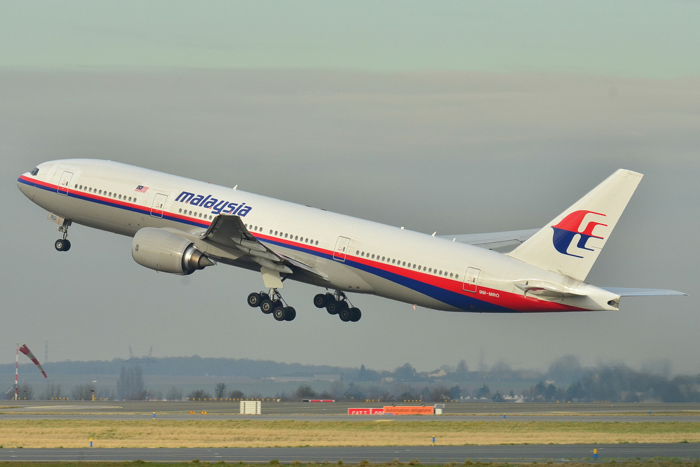 Description of . This photo provided by Laurent Errera taken Dec. 26, 2011, shows the Malaysia Airlines Boeing 777-200ER that disappeared from air traffic control screens Saturday, taking off from Roissy-Charles de Gaulle Airport in France. The Malaysia Airlines Boeing 777-200 carrying 239 people lost contact with air traffic control early Saturday morning, March 8, 2014 on a flight from Kuala Lumpur to Beijing, and international aviation authorities still hadn't located the jetliner several hours later. (AP Photo/Laurent Errera)