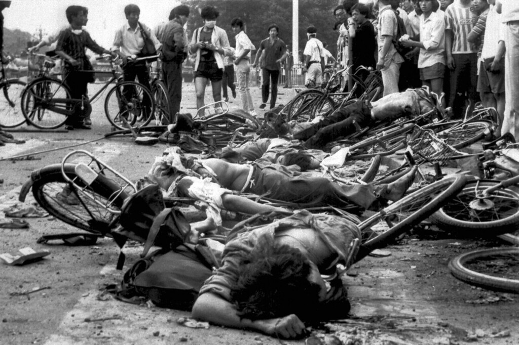 . The bodies of dead civilians lie among mangled bicycles near Beijing\'s Tiananmen Square in this June 4, 1989 file photo.    (AP Photo/File)