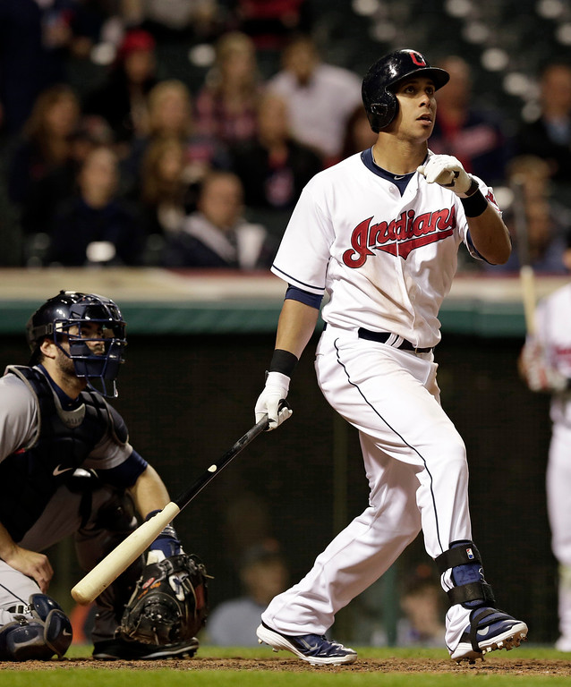 . Cleveland Indians\' Michael Brantley watches his ball after hitting a game-winning solo home run off Detroit Tigers relief pitcher Al Alburquerque in the tenth inning of a baseball game, Monday, May 19, 2014, in Cleveland. Tigers catcher Alex Avila watches. The Indians won 5-4 in ten innings. (AP Photo/Tony Dejak)