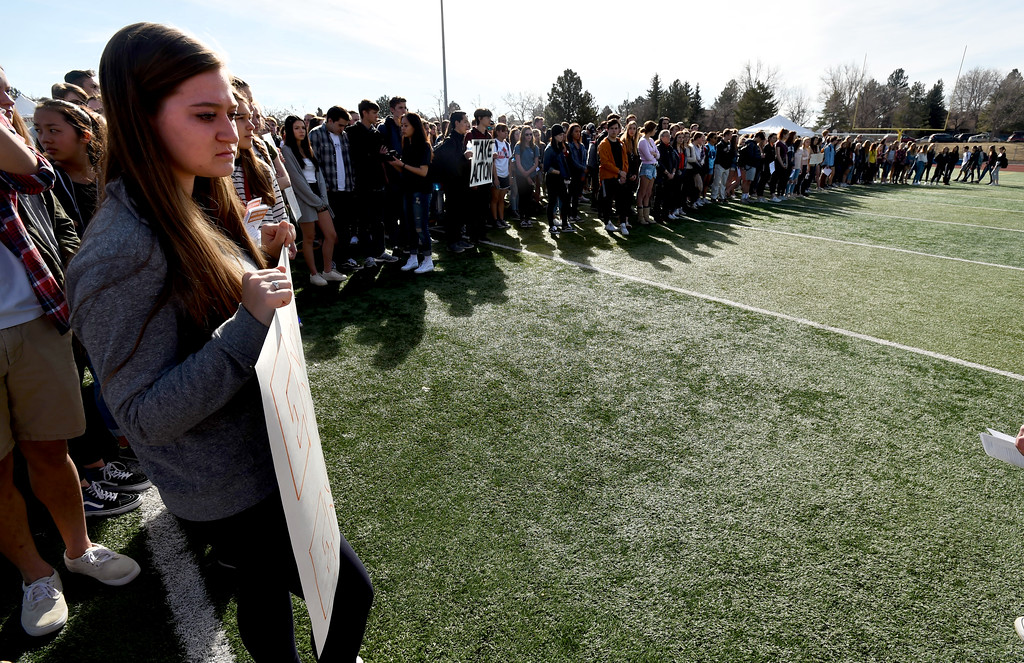 """. Rachel Heilbronner, left, holds the \""""Enough is Enough\"""" sign  at Fairview High School in Boulder. Students at schools across Boulder County and Broomfield walked out of class around 10 this morning as they took part in the nationwide protest of gun violence on the one-month anniversary of the massacre at a high school in Parkland, Fla., that left 17 dead. Cliff Grassmick  Photographer  March 14, 2018"""