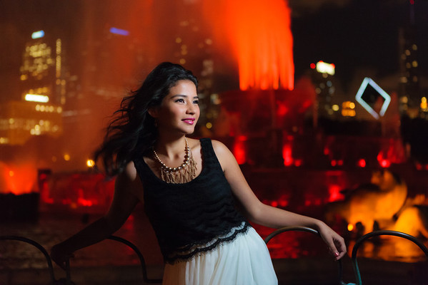 Photograph of Merina in front of Buckingham Fountain at night.